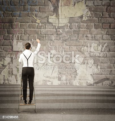 istock business girl write advertising on road wall 514298455
