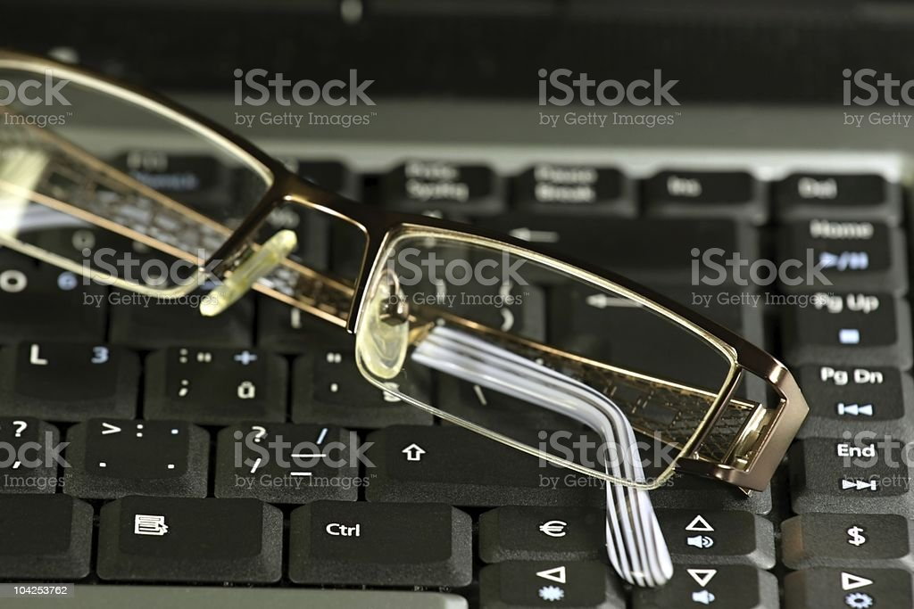 Business glasses on a laptop keyboard royalty-free stock photo