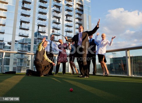 Business people playing golf in a corporate environment