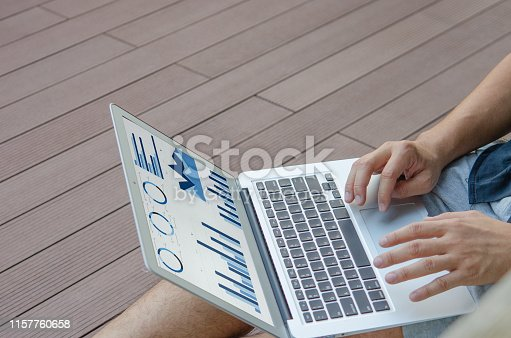 801895196 istock photo business graph and laptop 1157760658