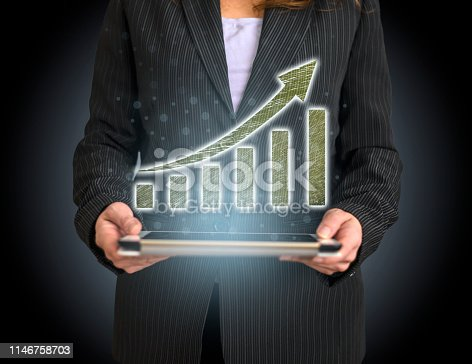 527033580 istock photo Business Graph Concept on Tablet with Hologram 1146758703