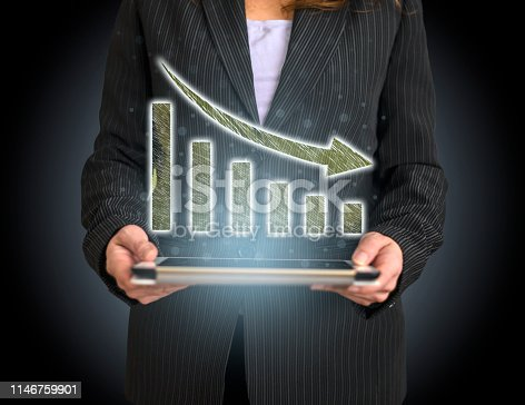 527033580 istock photo Business Graph Concept on Tablet with Hologram 1146759901