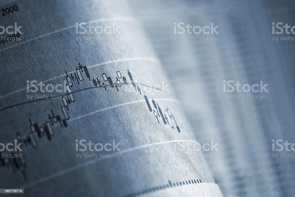 Business graph in newspaper stock photo