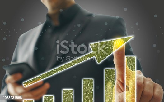 istock Business Graph on Touch Screen 1068534888