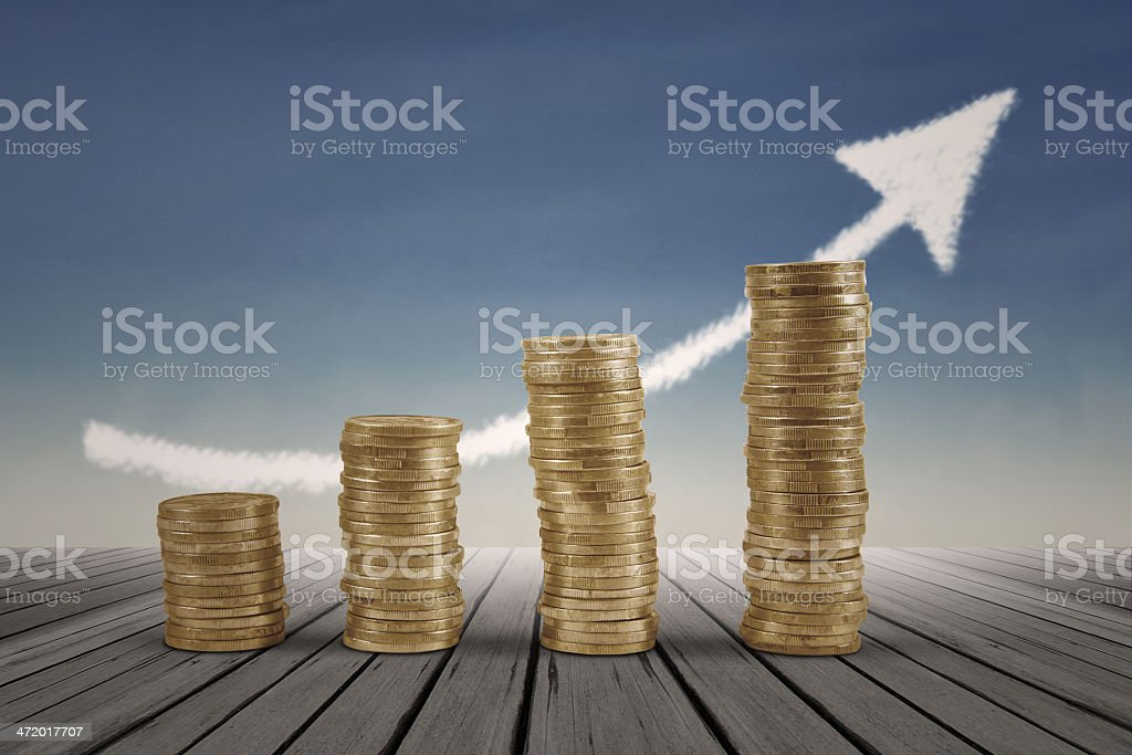 Business graph with arrow and coins stock photo