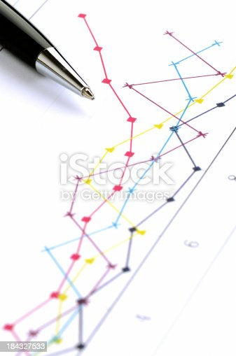 A pen pointing at the stock / sale market data.