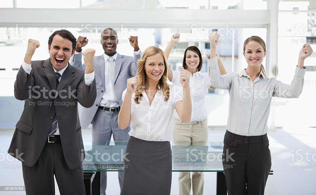 Business group celebrating in the office royalty-free stock photo