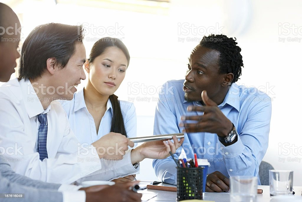 Business group discussing material quality stock photo