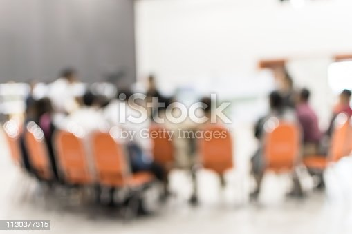 istock Business group discussion blur background with people in brainstorming team working together in teamwork for corporate strategy, strategic planning solution in meeting room or seminar lecture hall 1130377315