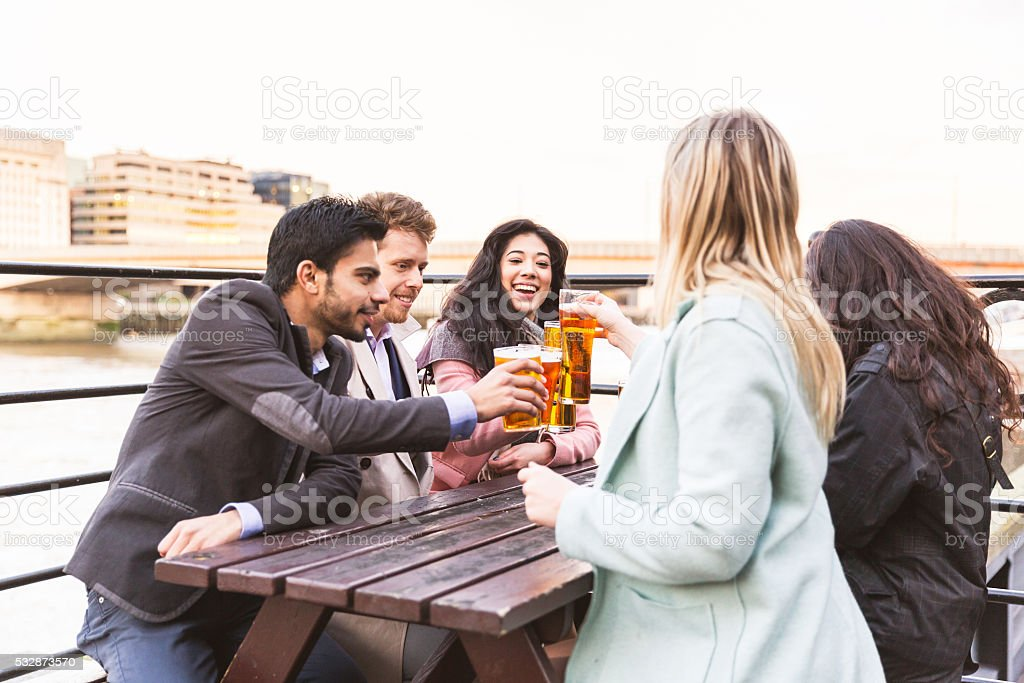 Business group drinking beer after work in London stock photo