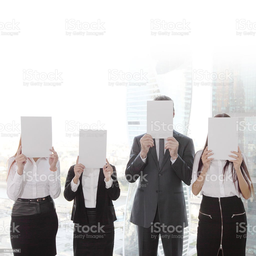 Business group holding white papers foto de stock libre de derechos