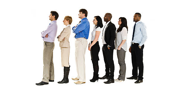 Business group in a row Business group in a row - isolated over a white background people in a row stock pictures, royalty-free photos & images