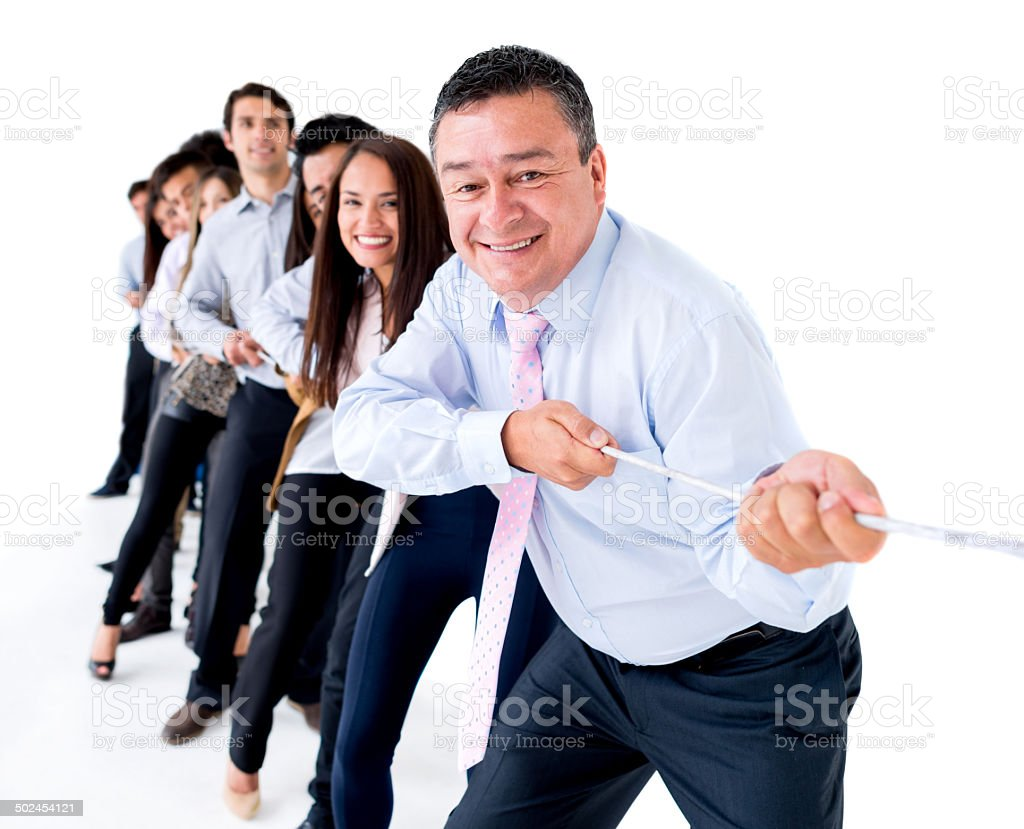 Business group pulling a rope stock photo