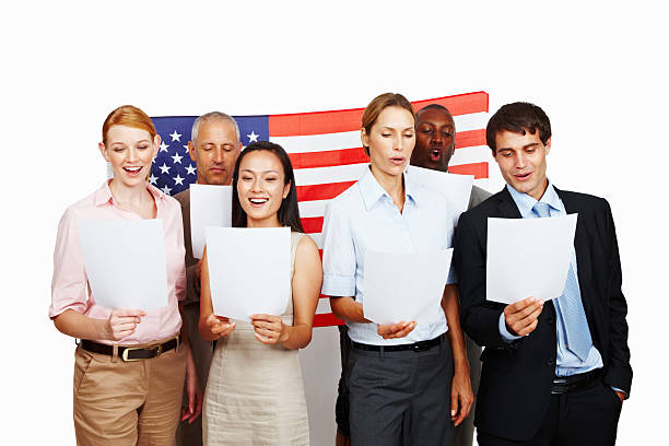 business group singing national anthem - national anthem stock photos and pictures