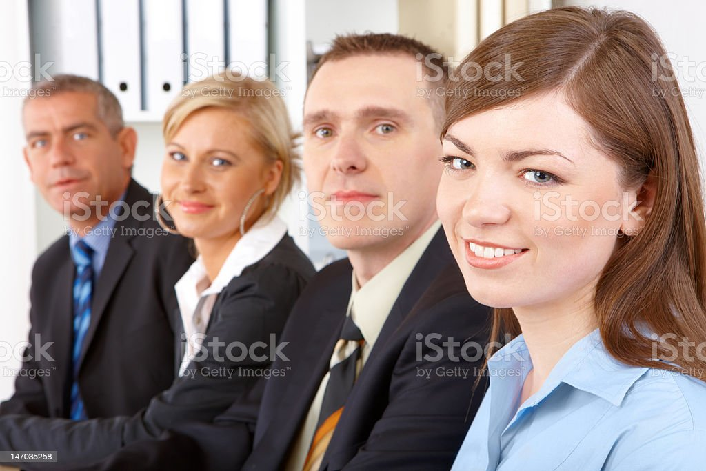 Business group sitting in row royalty-free stock photo