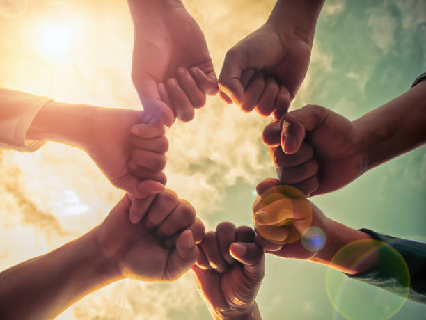 Business group with hands together, teamwork concepts stock photo