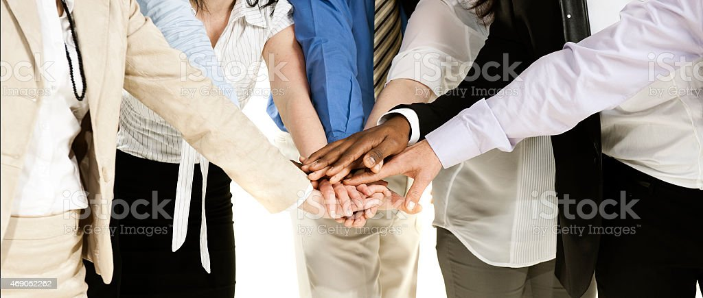 Business group with their hands together Business group with their hands together.Isolated on white. 2015 Stock Photo