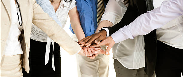 Business group with their hands together