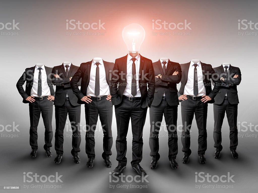 Business group without heads and one businessman in the center stock photo