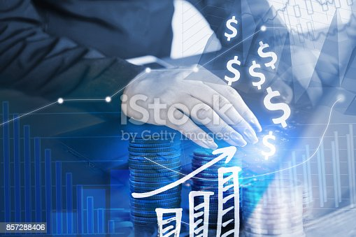 istock business growth and finance concept ,coins, woman hand typing on laptop , stock chart 857288406