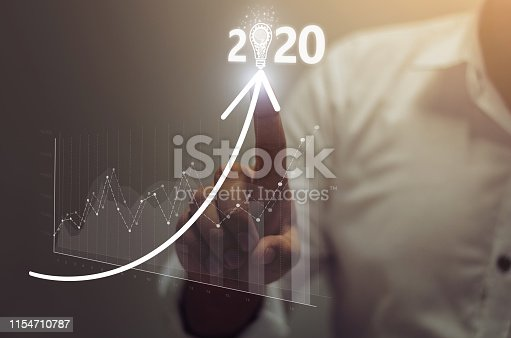 Businessman plan growth and increase of positive indicators in his business. Business growth concept year 2020