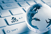 Business growth in 2017 year - 2017 key and global earth ( europe map ) on enter Computer laptop Keyboard