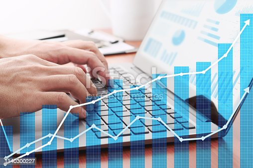 istock Business growth planning. Businessman analyzing data and preparing reports. 1140300227