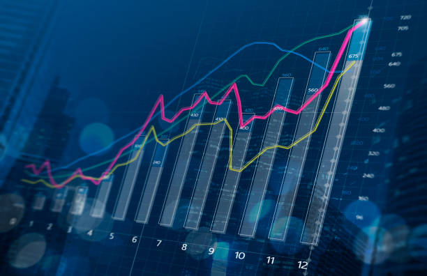 Business growth, progress or success concept. Financial bar chart and growing graphs with depth of field on dark blue background. Business growth, progress or success concept. Financial bar chart and growing graphs with depth of field on dark blue background. performance stock pictures, royalty-free photos & images