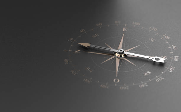 Business Guidance Or Orientation Concept. Compass over Black Background stock photo