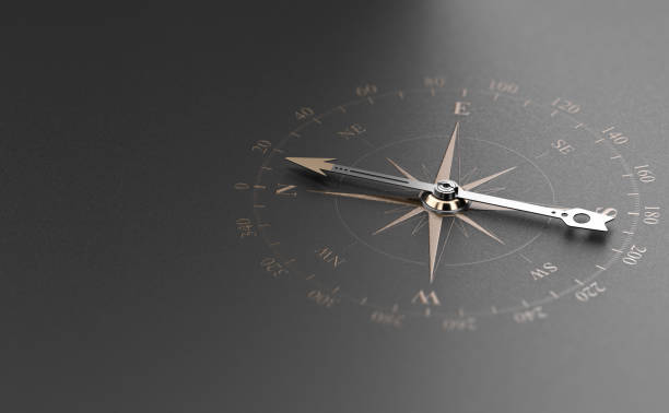 business guidance or orientation concept. compass over black background - compass zdjęcia i obrazy z banku zdjęć