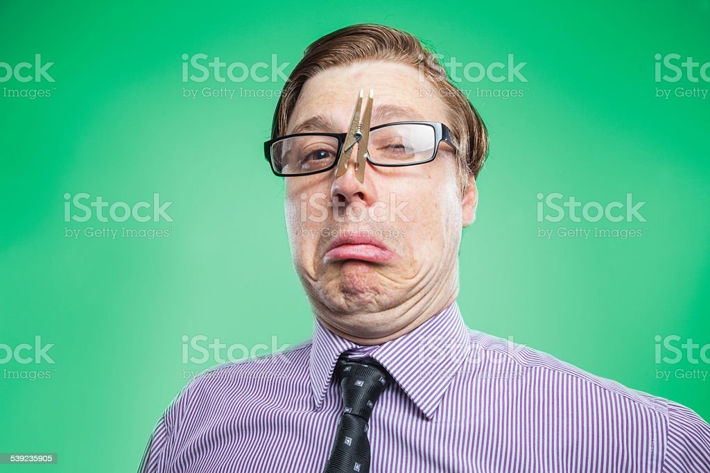 Business guy smells something awful royalty-free stock photo