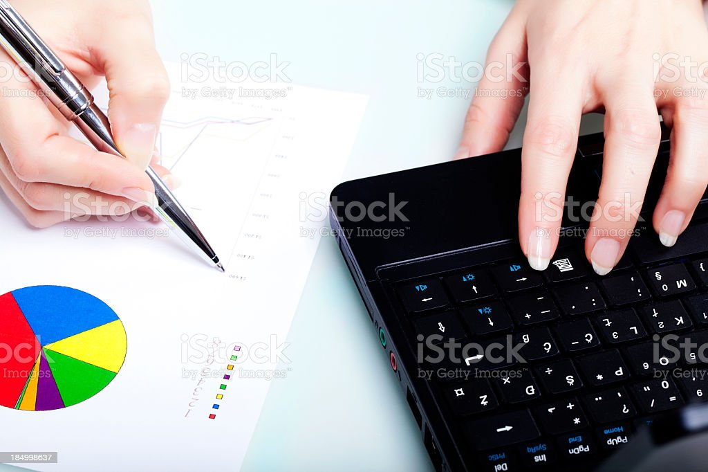 Business Hand and Graphs royalty-free stock photo