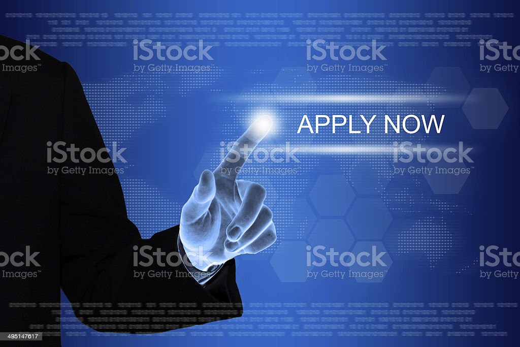 business hand clicking apply now button on touch screen stock photo