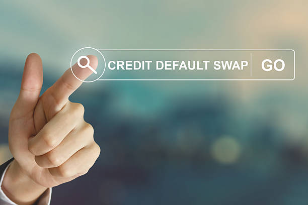 business hand clicking credit default swap button stock photo