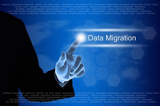 business hand clicking data migration button on touch screen stock photo