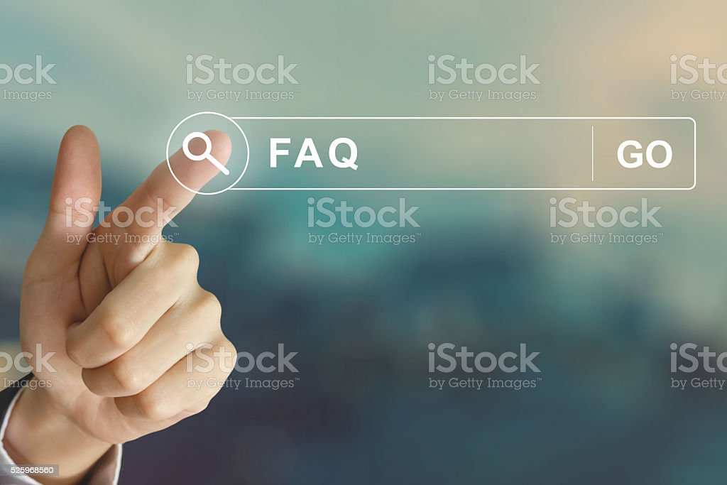 business hand clicking FAQ or Frequently asked questions button stock photo