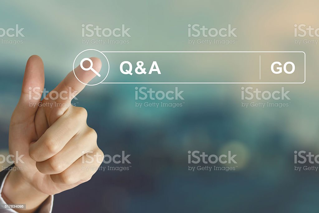 business hand clicking Q&A or Question and Answer button stock photo