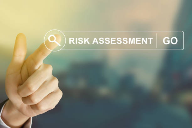business hand clicking risk assessment button on search toolbar stock photo