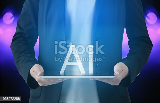 istock business hand holding an empty digital tablet with AI, Artificial intelligence , learning, data mining and another modern computer internet in every day lifes 958272268