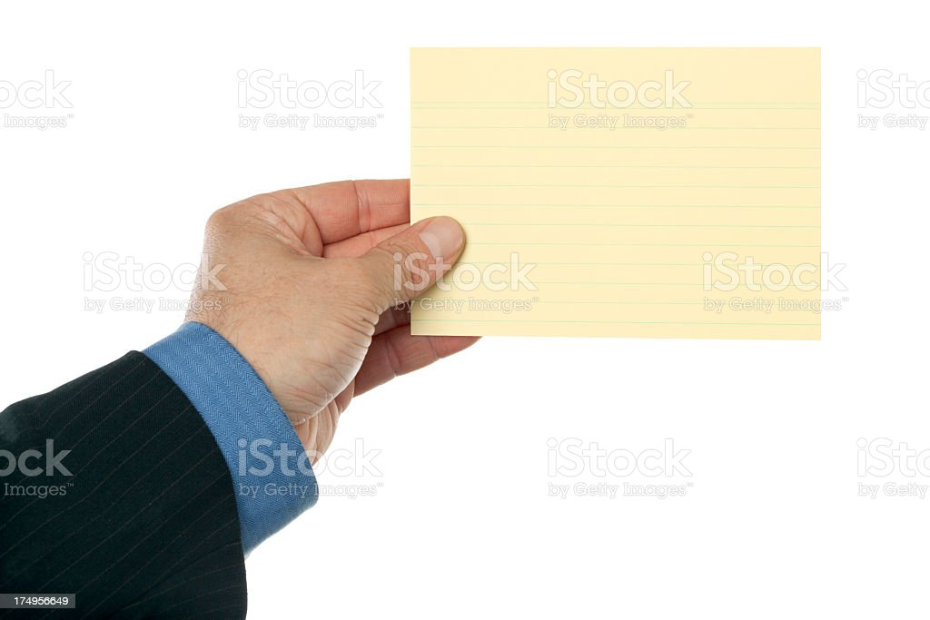 Business hand holding yellow index card royalty-free stock photo