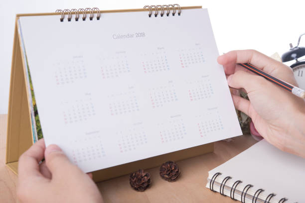business hand list calendar 2018 planner meeting on desk office. organization management remind concept. - timeline visual aid stock photos and pictures