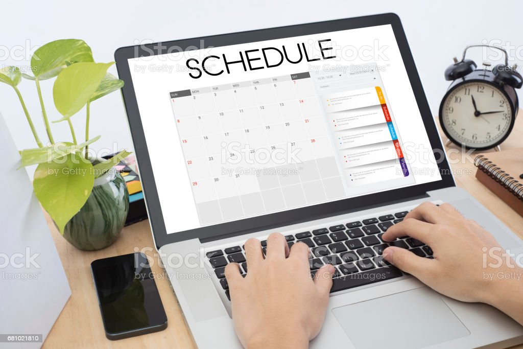 business hand list Calender Planner meeting on computer keyboard. organization management remind concept. royalty-free stock photo