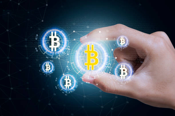 Business hand press offer bitcoin stock on tablet. concept investment finance digital technology. stock photo
