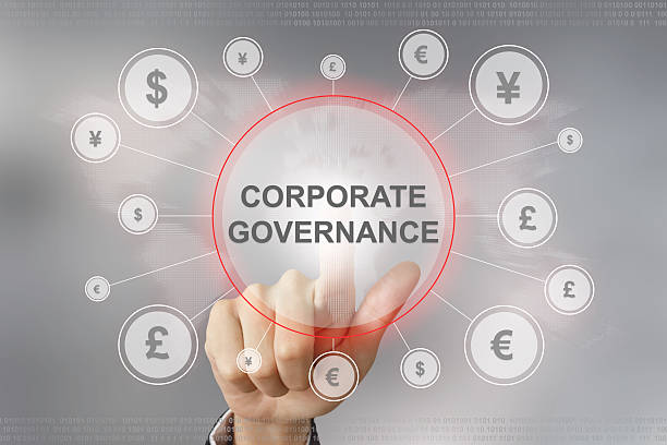 business hand pushing corporate governance button stock photo