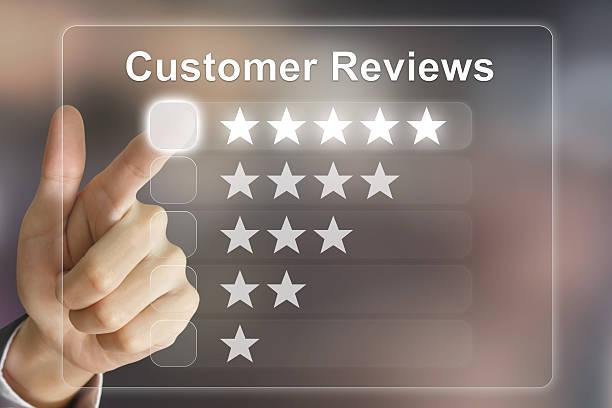 business hand pushing customer reviews on virtual screen stock photo