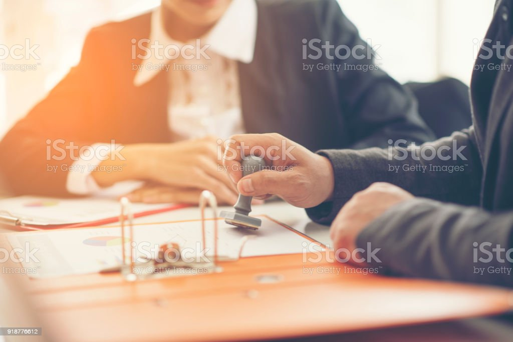 Business hand putting stamp on a document, close up - foto stock