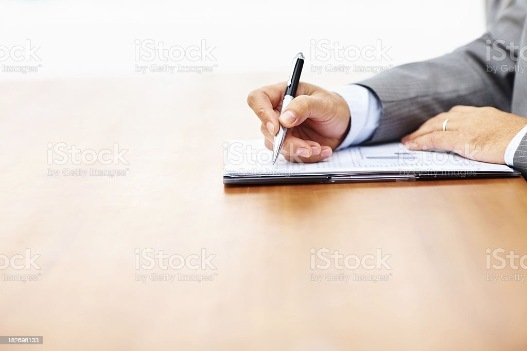 Business hand signing a contract royalty-free stock photo