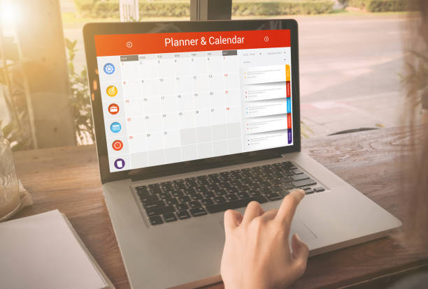 business hand typing on a laptop keyboard with calender planner - timeline visual aid stock photos and pictures