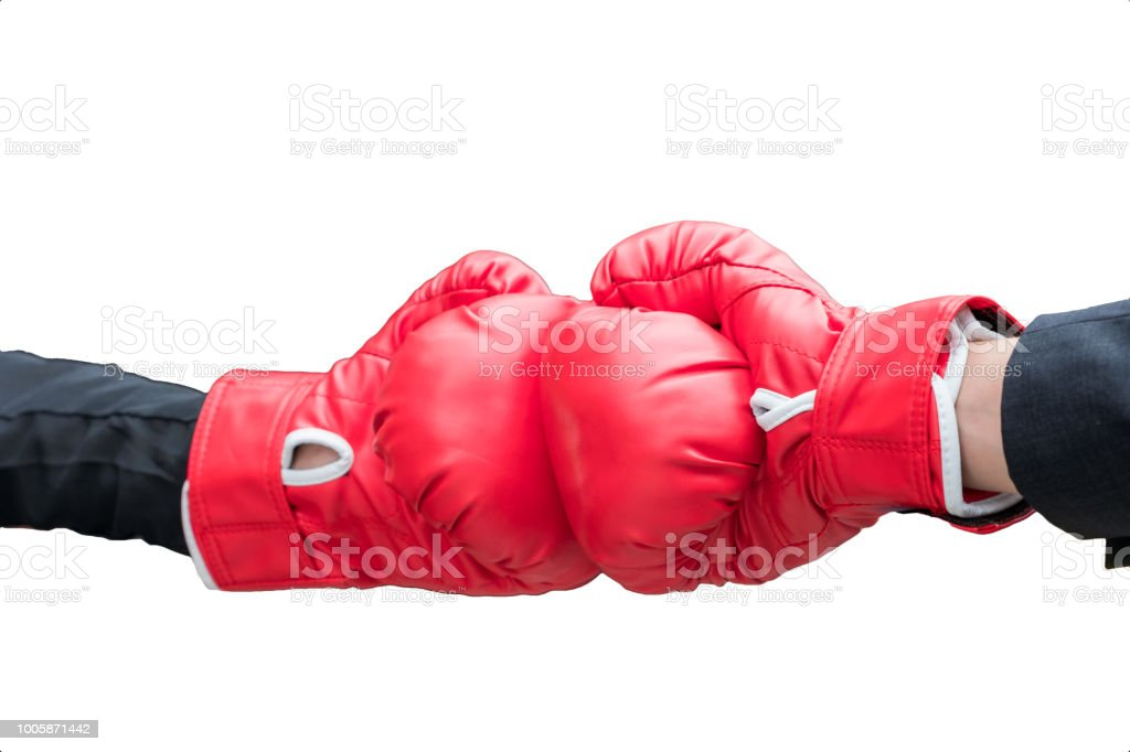 Business hand wearing suit with boxing gloves are fight and strike stock photo
