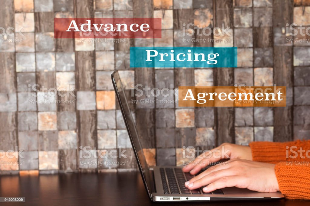 Business Hand Women Using A Laptop And Advance Pricing Agreement